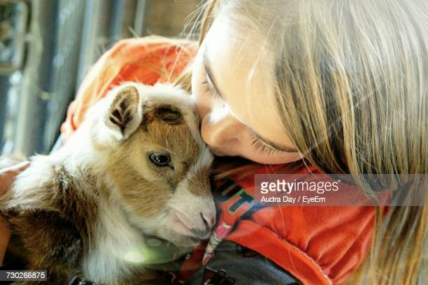 Close-Up Of Girl With Goat