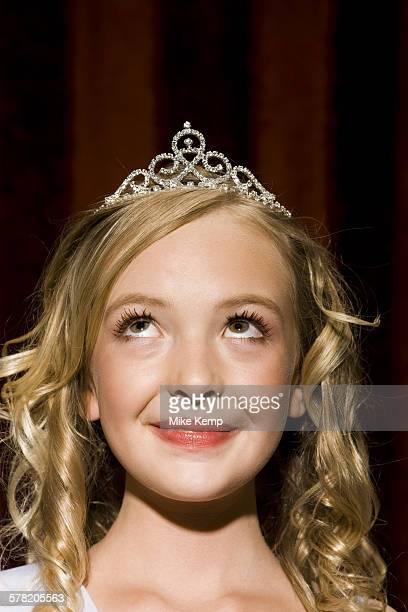 Closeup of girl with tiara looking up smiling