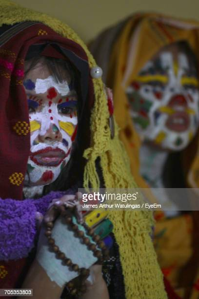 Close-Up Of Girls With Face Paint And Traditional Clothing