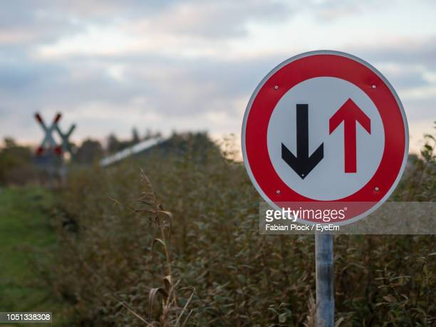 close-up of give way road sign in countryside against sky - rules stock pictures, royalty-free photos & images