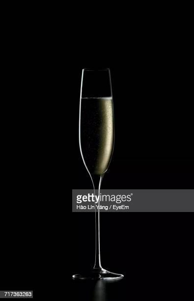 close-up of glass against black background - champagne flute stock pictures, royalty-free photos & images