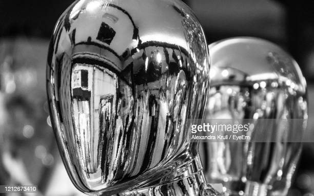 close-up of glass ball with reflection - chrome stock pictures, royalty-free photos & images
