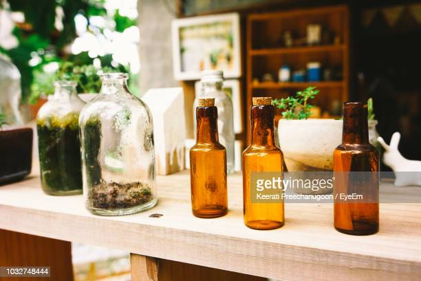 close-up of glass bottles on table - aromatherapy oil stock pictures, royalty-free photos & images