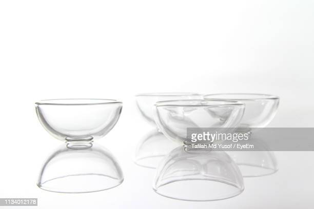 close-up of glass bowls on white background - 深皿 ストックフォトと画像