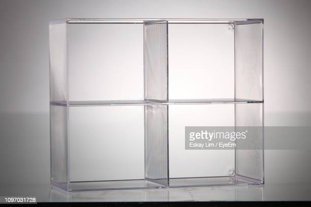 Close-Up Of Glass Box Over Gray Background