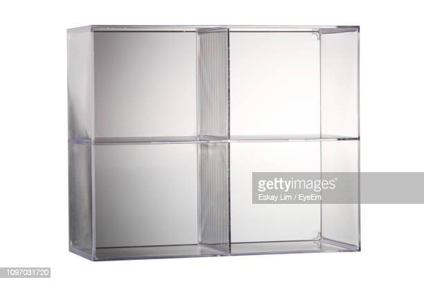 Close-Up Of Glass Box Over White Background