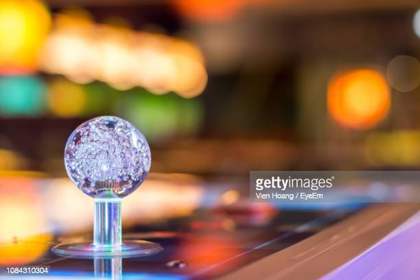 Close-Up Of Glass Decoration On Table In Nightclub