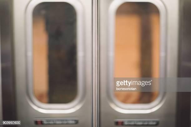 close-up of glass doors in train - bortes stock-fotos und bilder