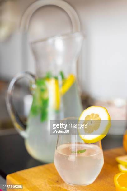 close-up of glass of lemonade in kitchen - infused water stock pictures, royalty-free photos & images