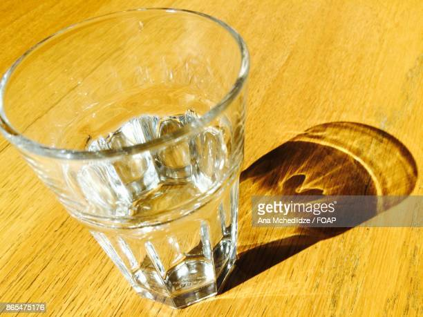 Close-up of glass on wooden table
