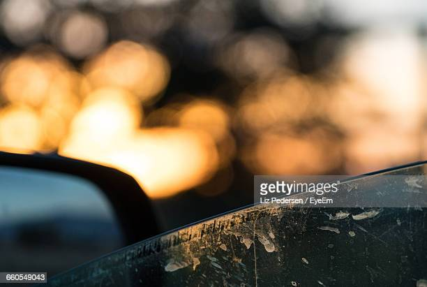Close-Up Of Glass Window Of Car During Sunset