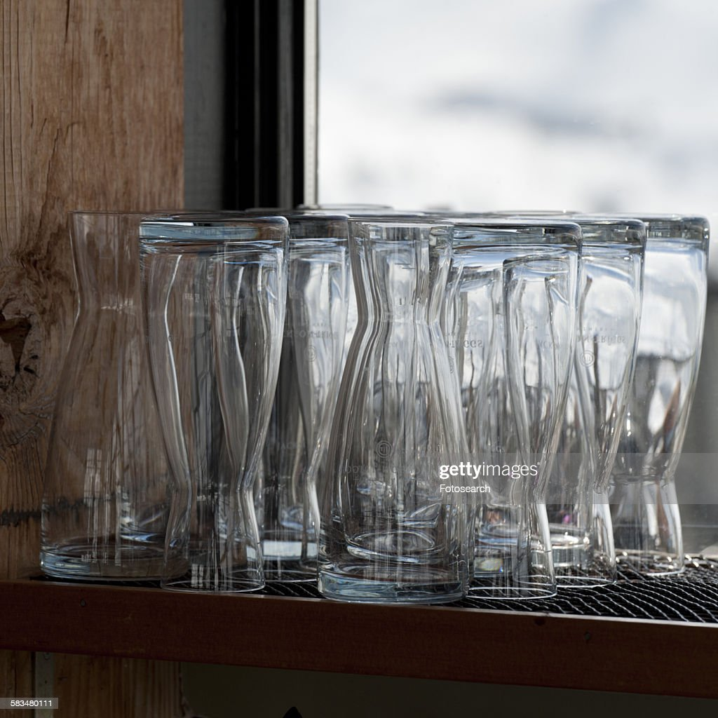 Close-up of glasses on a shelf : Stock Photo