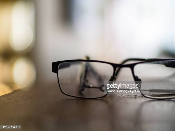 close-up of glasses on table at home - colbing stock pictures, royalty-free photos & images