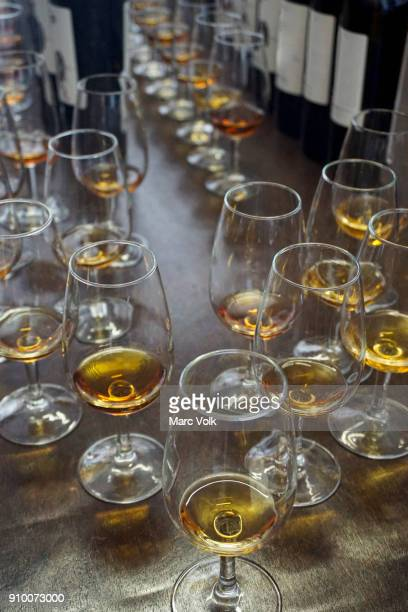 close-up of glasses with madeira wine on bar counter - madeira stockfoto's en -beelden
