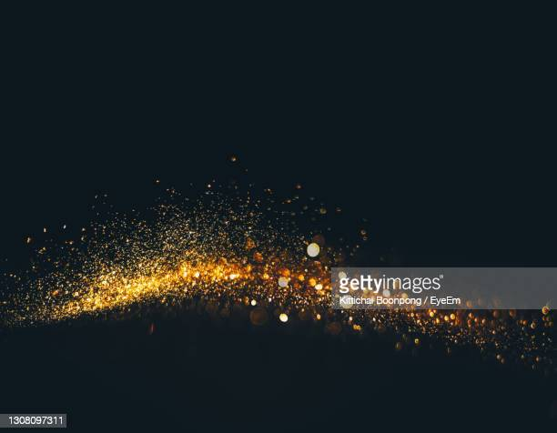close-up of glitter against black background - shiny stock pictures, royalty-free photos & images