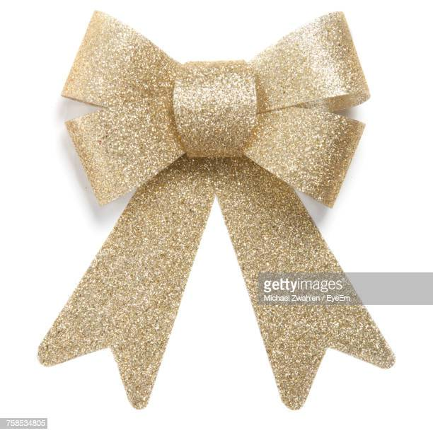 close-up of glittering bow tie against white background - christmas decorations stock photos and pictures