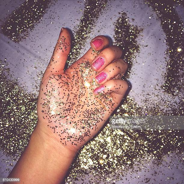 Close-up of glittering hand