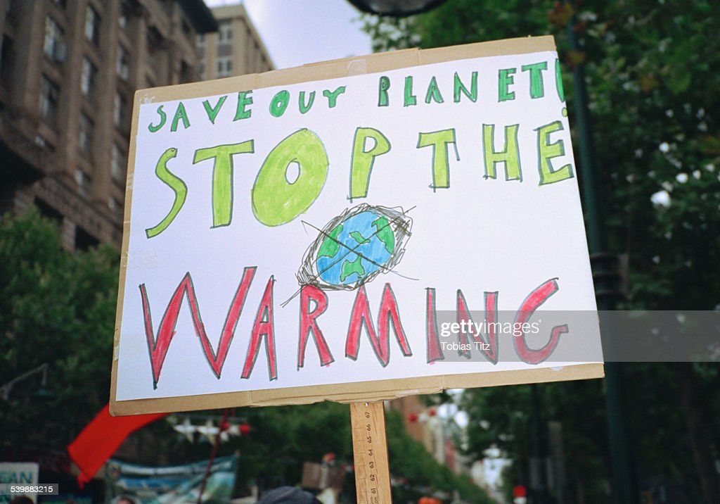 Close-up of global warming sign in city : Stock Photo