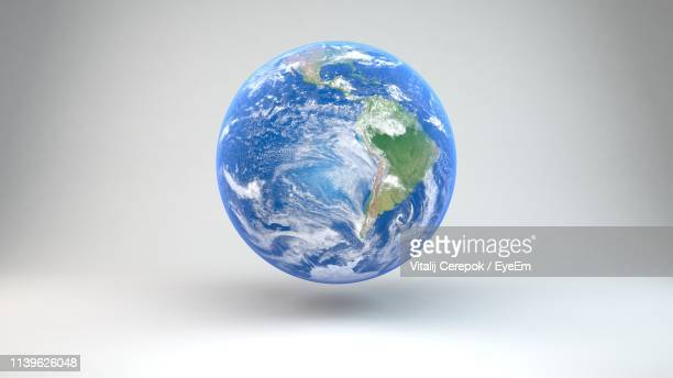 close-up of globe against white background - pianeta terra foto e immagini stock