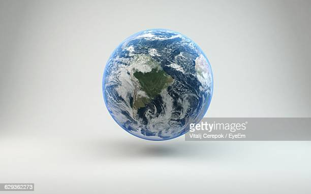 close-up of globe against white background - planet earth stock pictures, royalty-free photos & images