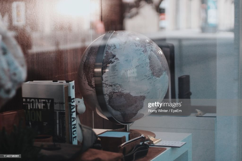 Close-Up Of Globe On Table In Office : Stock Photo