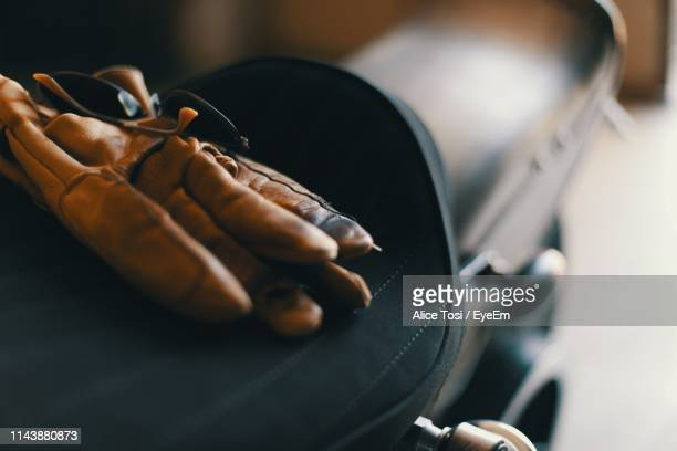 close-up of glove on motorcycle - leather glove stock pictures, royalty-free photos & images