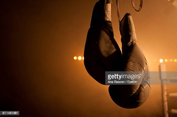 Close-Up Of Gloves Hanging Boxing Ring
