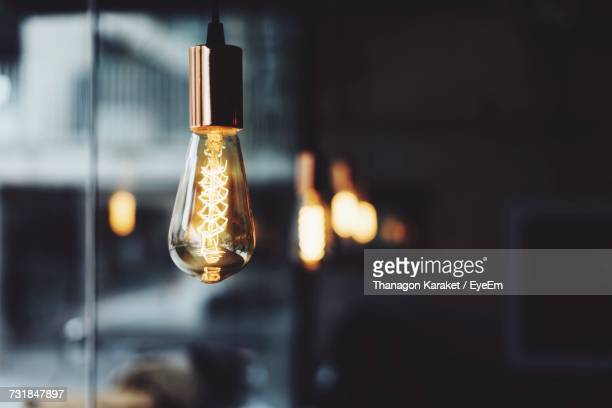 close-up of glowing electric bulb - light bulb stock pictures, royalty-free photos & images
