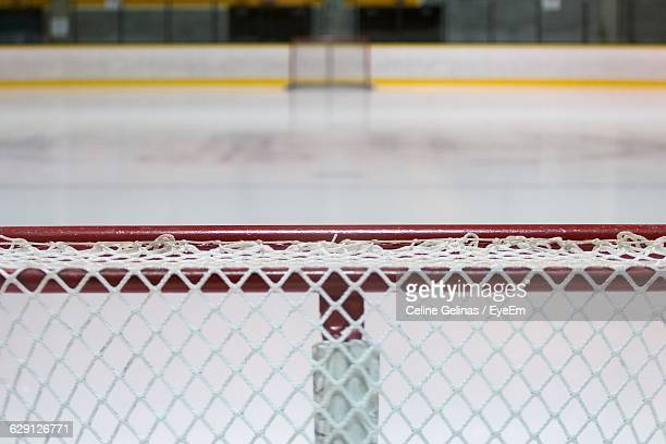 close-up of goal post at ice hockey rink - hockey rink stock photos and pictures