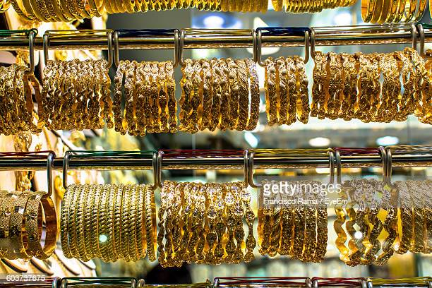 Close-Up Of Gold Bangles For Sale At Store