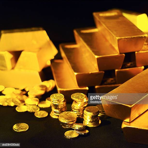 Close-up of gold bars and stacks of one euro coins