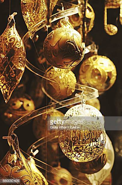Close-Up Of Gold Colored Christmas Ornaments