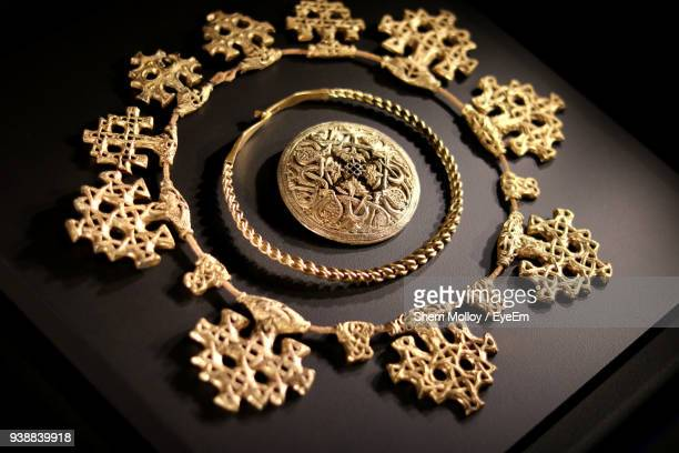 close-up of gold colored jewelry on table - necklace stock pictures, royalty-free photos & images