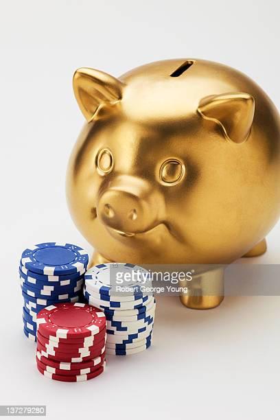 Closeup of Gold Piggy Bank & Poker Chips