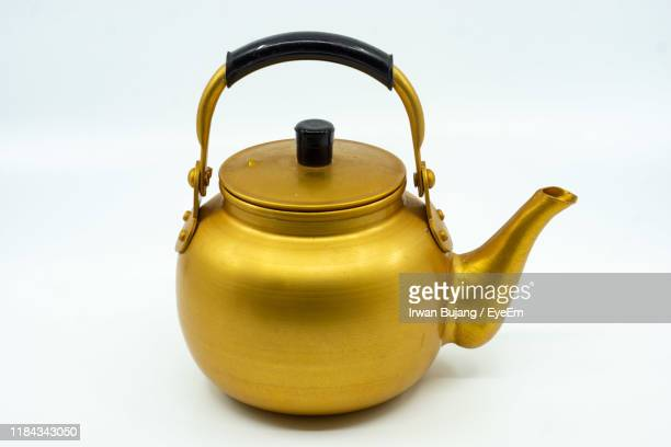 close-up of golden kettle against white background - やかん ストックフォトと画像