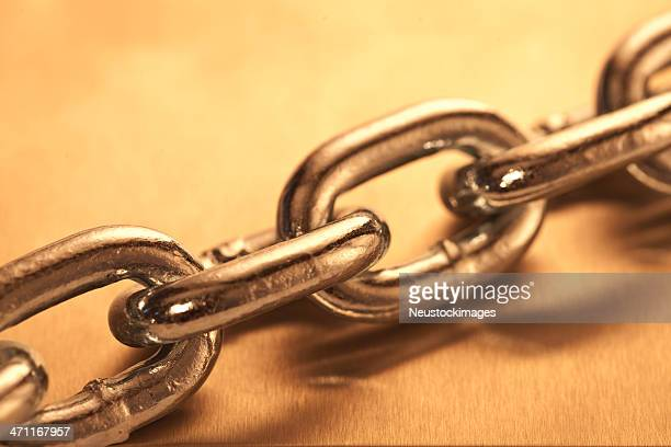 Closeup of golden link chain isolated on a background