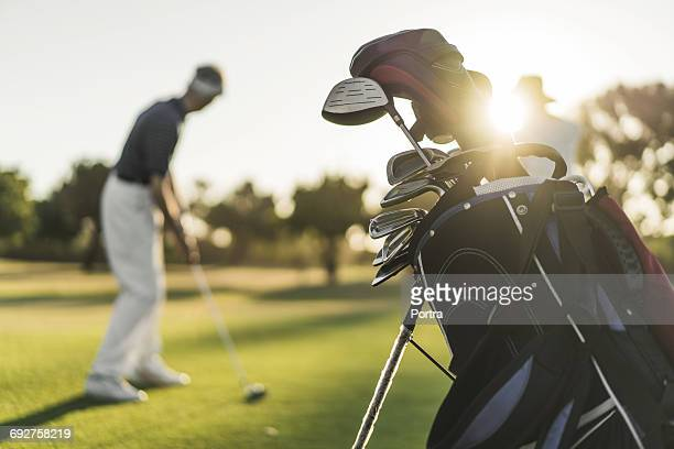 close-up of golf bag with people in background - golfe imagens e fotografias de stock