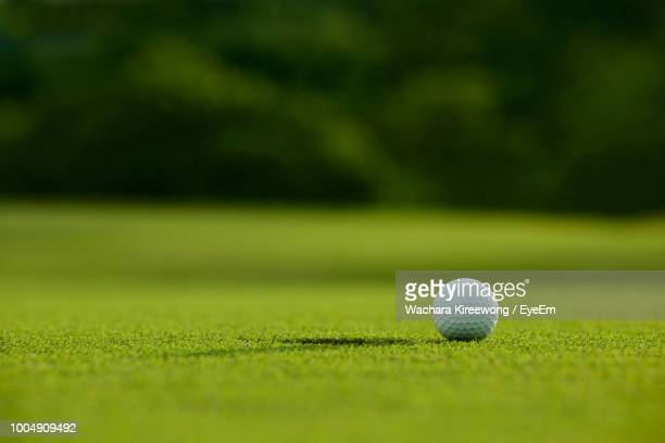 close-up of golf ball on playing field - green golf course stock pictures, royalty-free photos & images