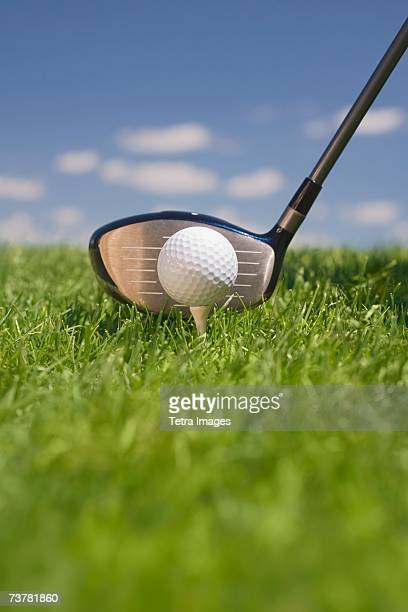 close-up of golf ball teed up for play - driver golf club stock pictures, royalty-free photos & images