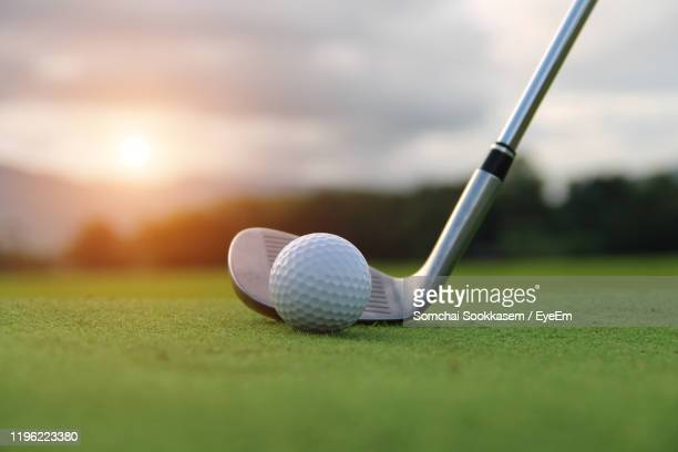close-up of golf club and ball on grass - golf tournament stock pictures, royalty-free photos & images