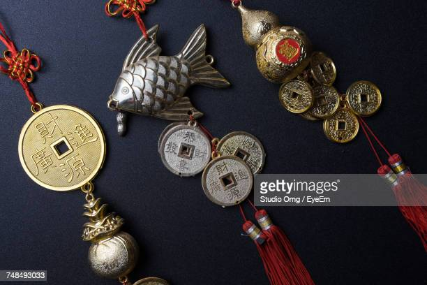 Close-Up Of Good Luck Charms On Table