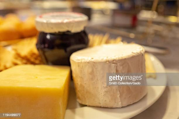 Close-up of gourmet cheese plate with Neal's Yard cheddar cheese and Mount Tam triple cream cheese, San Ramon, California, December 15, 2019.