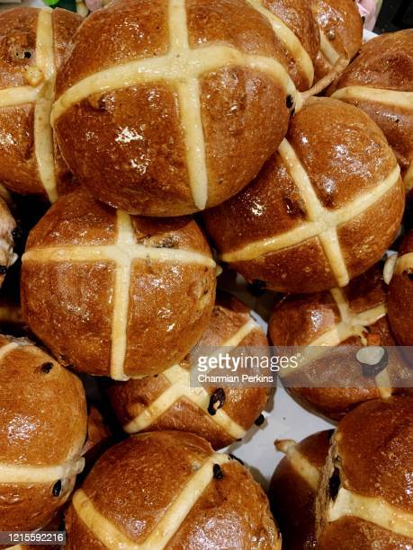 closeup of gourmet organic hot cross buns for easter, traditional easter food in britain - bun stock pictures, royalty-free photos & images
