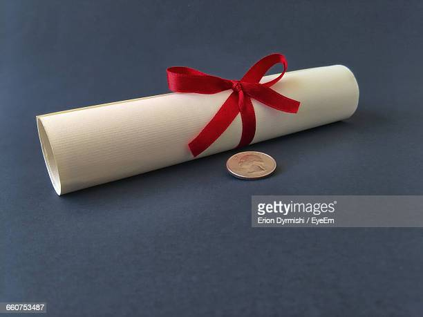 close-up of graduation diploma with medal on table - diploma stock photos and pictures
