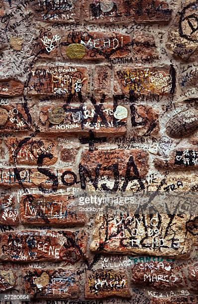 Close-up of graffiti on a brick wall in Verona, Italy