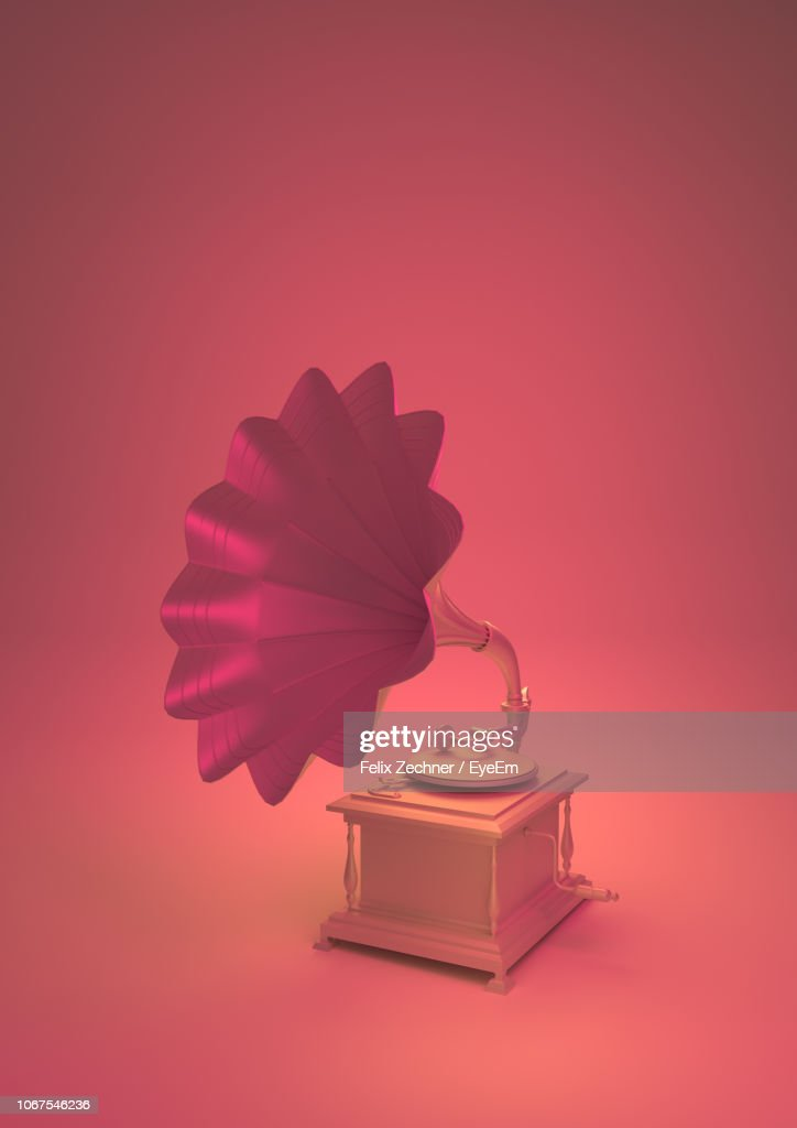 Close-Up Of Gramophone Against Coral Background : Stock Photo
