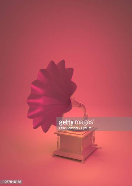 close-up of gramophone against coral background - gramophone stock pictures, royalty-free photos & images