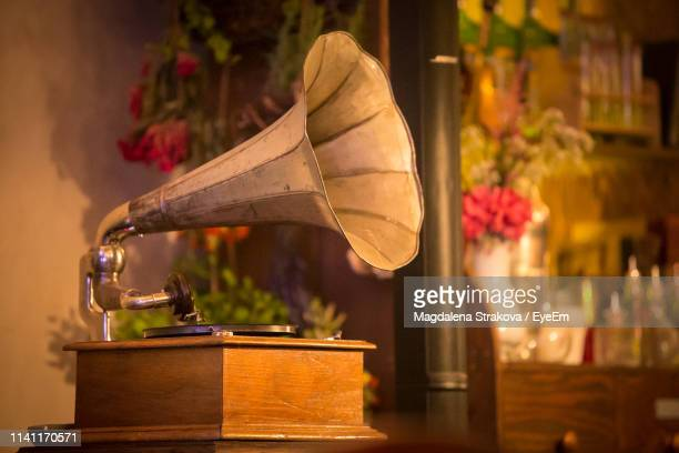 close-up of gramophone on table at store - gramophone stock pictures, royalty-free photos & images