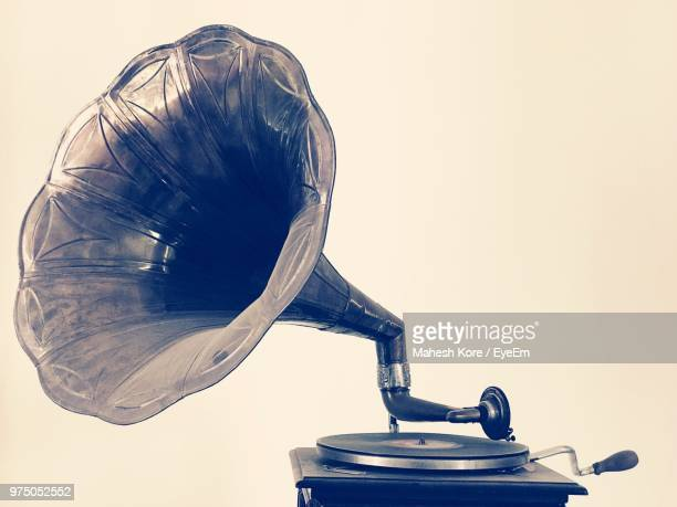 close-up of gramophone on table - gramophone stock pictures, royalty-free photos & images