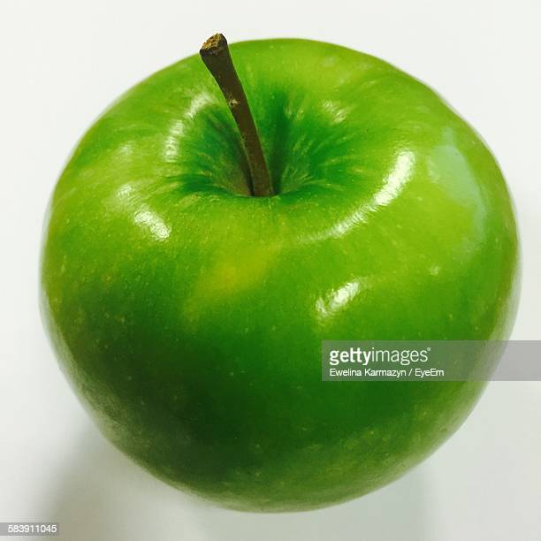 Close-Up Of Granny Smith Apple Against White Background